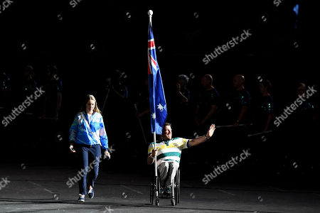 Stock Photo of Flagbearer Kurt Fearnley enters the stadium before the start of the closing ceremony of the XXI Commonwealth Games on the Gold Coast, Australia,, 15 April 2018.