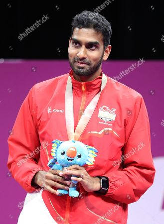 Bronze medalist Rajiv Ouseph of England stands on the podium during the medal ceremony for men's singles badminton at Carrara Sports Hall during the Commonwealth Games on the Gold Coast, Australia