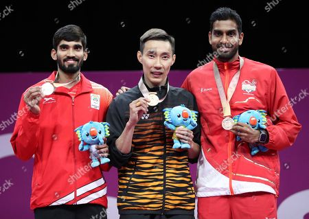 From left to right, silver medalist India's Srikanth Kidambi of India, gold medalist Lee Chong Wei of Malaysia and bronze medalist Rajiv Ouseph of England show their medal during the medal ceremony for men's singles badminton at Carrara Sports Hall during the Commonwealth Games on the Gold Coast, Australia
