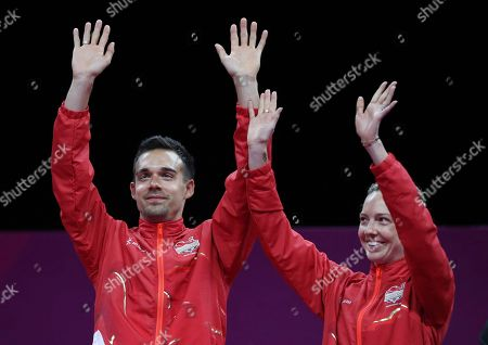 Gold medalists Gabrielle Adcock, right, and Chris Adcock of England celebrate on the podium during the medal ceremony for mixed doubles badminton at Carrara Sports Hall during the Commonwealth Games on the Gold Coast, Australia