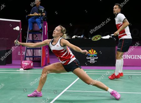 England's Chris Adcock, right, and Gabrielle Adcock play against their compatriots Marcus Ellis and Lauren Smith during their mixed doubles badminton final at Carrara Sports Hall during the Commonwealth Games on the Gold Coast, Australia
