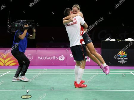 England's Chris Adcock and Gabrielle Adcock celebrate after defeating their compatriots Marcus Ellis and Lauren Smith during their mixed doubles badminton final at Carrara Sports Hall during the Commonwealth Games on the Gold Coast, Australia