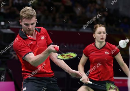 England's Marcus Ellis, left, and Lauren Smith play against their compatriots Gabrielle Adcock and Chris Adcock during their mixed doubles badminton final at Carrara Sports Hall during the Commonwealth Games on the Gold Coast, Australia