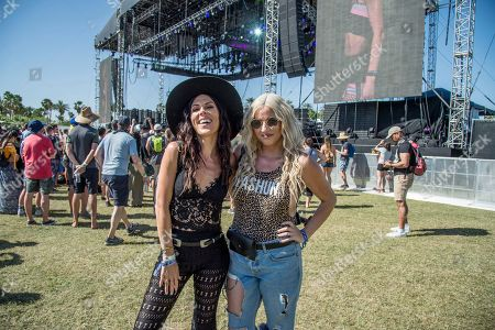Joslyn Davis, Lilly Marston. Joslyn Davis, left, and Lilly Marston, of Los Angeles, attend the Coachella Music & Arts Festival at the Empire Polo Club, in Indio, Calif