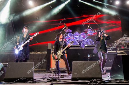 Stock Photo of Heath, Richard Fortus, Toshi, Sugizo. Heath, from left, Richard Fortus of Guns N Roses, Toshi and Sugizo of X Japan performs at the Coachella Music & Arts Festival at the Empire Polo Club, in Indio, Calif