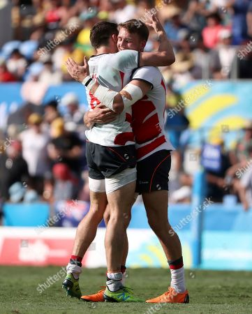 England's Harry Glover, right, and Alexander Davis embrace after defeating South Africa in their rugby sevens bronze medal match at Robina Stadium during the 2018 Commonwealth Games on the Gold Coast, Australia