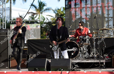 Stock Image of Rich Cole, Wally Palmar, Brad Elvis. Rich Cole, from left, Wally Palmar and Brad Elvis of The Romantics perform at Magic City Casino on in Miami, Fla