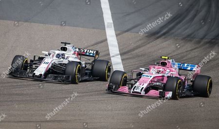 French Formula One driver Esteban Ocon of Sahara Force India F1 Team drives ahead of Canadian Formula One driver Lance Stroll of Williams during the Chinese Formula One Grand Prix at the Shanghai International circuit in Shanghai, China, 15 April 2018.