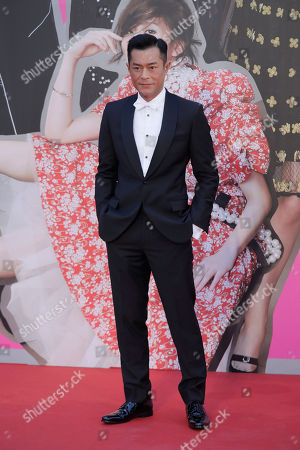 Hong Kong actor Louis Koo poses on the red carpet of the Hong Kong Film Awards in Hong Kong