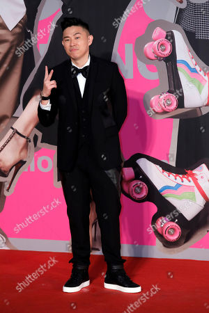 Stock Picture of American-born-Chinese rapper MC Jin poses on the red carpet of the Hong Kong Film Awards in Hong Kong