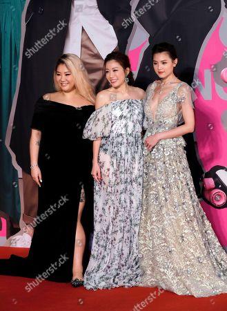 Joyce Cheng, Kearen Pang, Chrissie Chau. From left, Hong Kong actress Joyce Cheng, director Kearen Pang and actress Chrissie Chau pose on the red carpet of the Hong Kong Film Awards in Hong Kong