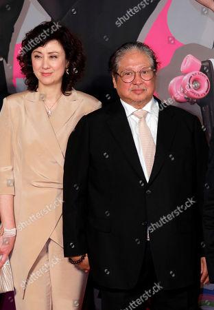 Sammo Hung, Joyce Godenzi. Hong Kong actor-director Sammo Hung, and his wife Joyce Godenzi pose on the red carpet of the Hong Kong Film Awards in Hong Kong