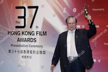 "Hong Kong director Sammo Hung poses after winning the Best Action award for his movie ""Paradox"" during the Hong Kong Film Awards in Hong Kong"