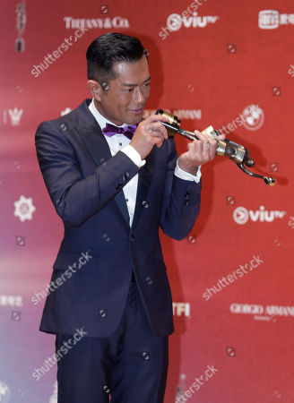 "Hong Kong actor Louis Koo poses after winning the Best Actor award for his movie ""Paradox"" during the Hong Kong Film Awards in Hong Kong"