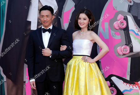Charlene Choi, Louis Cheung. Hong Kong actress Charlene Choi, right, and Louis Cheung pose on the red carpet of the Hong Kong Film Awards in Hong Kong