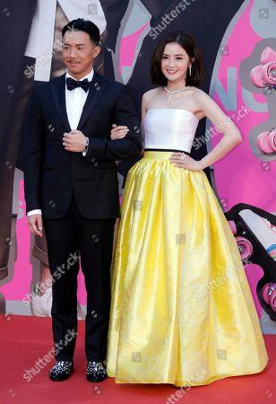 Charlene Choi, Louis Cheung. Hong Kong actress Charlene Choi, right, and Louis Cheung pose on the red carpet of the Hong Kong Film Awards in Hong Kong