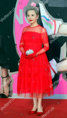 Hong Kong actress Deanie Ip poses on the red carpet of the Hong Kong Film Awards in Hong Kong