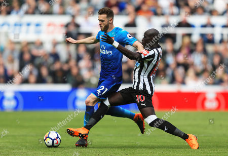 Mohamed Diame of Newcastle United tackles Calum Chambers of Arsenal