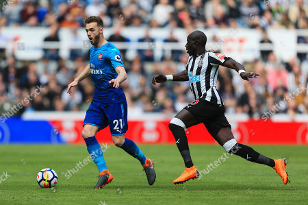 Calum Chambers of Arsenal and Mohamed Diame of Newcastle United