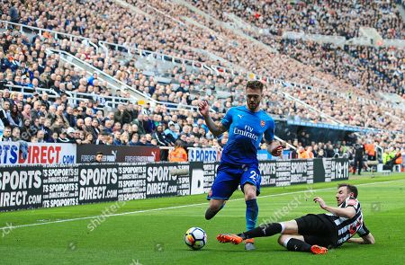 Paul Dummett of Newcastle United tackles Calum Chambers of Arsenal