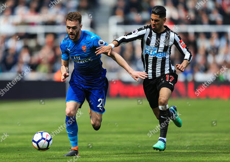 Calum Chambers of Arsenal takes on Ayoze Perez of Newcastle United