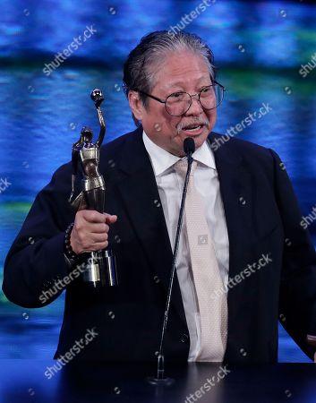 Stock Picture of Hong Kong action director Sammo Hung raises his Best Action Choreography award for his movie ' Paradox ' at the 37th Hong Kong Film Awards in Hong Kong
