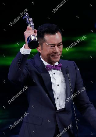 Hong Kong actor Louis Koo raises his Best Actor award for the movie 'Paradox' at the 37th Hong Kong Film Awards in Hong Kong