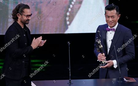 Louis Koo, Aamir Khanat. Hong Kong actor Louis Koo, right, reacts after receiving his Best Actor award for the movie 'Paradox' from Indian actor Aamir Khan at the 37th Hong Kong Film Awards in Hong Kong