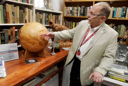 Center for Ray Bradbury Studies director Jonathan Eller points out the location of Gale Crater on the Mars globe, in Indianapolis. The globe presented to Ray Bradbury for his support of NASA's Mariner 9 Mars orbital mission in 1971
