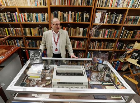 Center for Ray Bradbury Studies director Jonathan Eller stands behind Ray Bradbury's basement office recreation at IUPUI's Center for Ray Bradbury Studies, in Indianapolis. The display includes the author's desk, where Mr. Bradbury worked in his Los Angeles home for nearly half a century