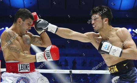 WBA middleweight champion Ryota Murata, right, delivers his right to Italian challenger Emanuele Blandamura during their WBA middleweight title bout in Yokohama near Tokyo, . Murata defended his title by technical knockout
