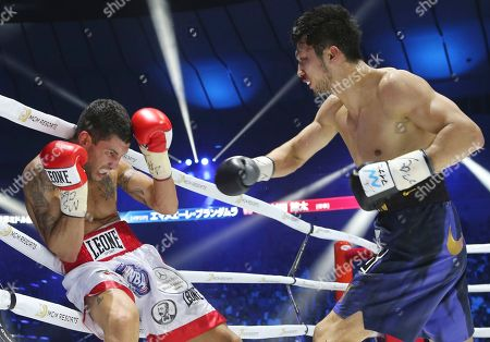 WBA middleweight champion Ryota Murata, right, delivers his right to Italian challenger Emanuele Blandamura during their WBA middleweight title bout in Yokohama near Tokyo, . Murata defeated his title by technical knockout
