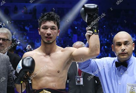 WBA middleweight champion Ryota Murata celebrates after defeating Italian challenger Emanuele Blandamura during their WBA middleweight title bout in Yokohama near Tokyo, . Murata defended his title by technical knockout