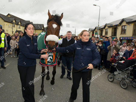 Aintree Grand National Winner Tiger Roll, trained by Gordon Elliott and ridden by Davy Russell homecoming parade through Summerhill. Co. Meath. Karen Morgan (Left) and Louise Dunne lead Aintree Grand National winner Tiger Roll on parade in Summerhill with trainer Gordon Elliott.