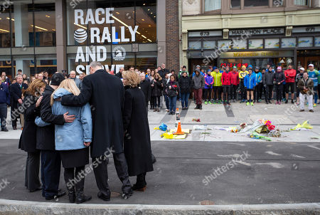 Massachusetts Governor Charlie Baker (2R) embraces Patty Campbell (C), mother of bombing victim Krystal Campbell, after placing a wreath at Marathon Sports at 671 Boylston St., the location of the first explosion, during a memorial ceremony on the fifth anniversary of the Boston Marathon Bombing, n Boston, Massachusetts, USA 15 April 2018. On 15 April 2013, two homemade bombs detonated 12 seconds and 210 yards (190 m) apart at 2:49 p.m., near the finish line of the annual Boston Marathon, killing three people and injuring several hundred others. Brothers Dzhokhar Tsarnaev and Tamerlan Tsarnaev were eventually sought for the crime which Tamerlan bing killed during a  police shootout and Dzhokhar later captured, tried in court and sentenced to death and is currently awaiting appeal while in prison.