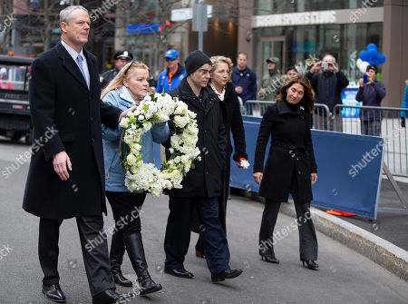 Stock Picture of Massachusetts Governor Charlie Baker (L) along with Patty Campbell (2L), mother of bombing victim Krystal Campbell, lay a wreath at Marathon Sports at 671 Boylston St., the location of the first explosion, during a memorial ceremony on the fifth anniversary of the Boston Marathon Bombing, n Boston, Massachusetts, USA 15 April 2018. On 15 April 2013, two homemade bombs detonated 12 seconds and 210 yards (190 m) apart at 2:49 p.m., near the finish line of the annual Boston Marathon, killing three people and injuring several hundred others. Brothers Dzhokhar Tsarnaev and Tamerlan Tsarnaev were eventually sought for the crime which Tamerlan bing killed during a  police shootout and Dzhokhar later captured, tried in court and sentenced to death and is currently awaiting appeal while in prison.