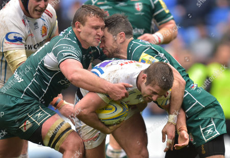 Jake Schatz of London Irish and James Marshall of London Irish clash heads when they try to tackle Santiago Cordero of Exeter Chiefs