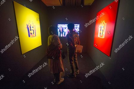 Festival visitors view images by the French artist Jean-Paul Goude at the 6th annual Kyotographie International Photography Festival opening party in Kyoto, Japan, 15 April 2018. The festival is being held from 14 April to 13 May.