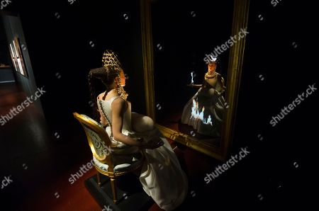 An actress looks in a mirror as performance created by French artist Jean-Paul Goude during his exhibition at the 6th annual Kyotographie International Photography Festival opening party in Kyoto, Japan, 15 April 2018. The festival is being held from 14 April to 13 May.