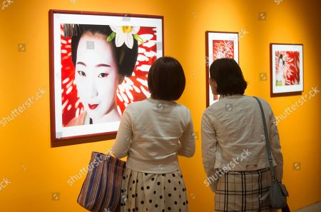 Japanese visitors look at images by Japanese artist Mika Ninagawa during the 6th annual Kyotographie International Photography Festival in Kyoto, Japan, 14 April 2018 (issued 15 April). The  festival is being held from 14 April to 13 May.