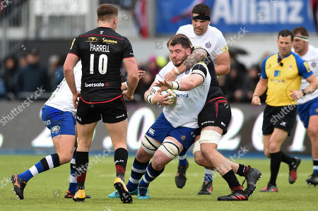 James Phillips of Bath Rugby is tackled by Dominic Day of Saracens