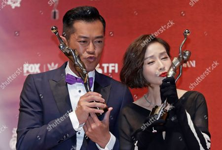 "Louis Koo, Teresa Mo. Hong Kong actor Louis Koo and actress Teresa Mo pose after winning the Best Actor award for his movie ""Paradox"", and Best Actress award for her movie ""Tomorrow Is Another Day"" during the Hong Kong Film Awards in Hong Kong"