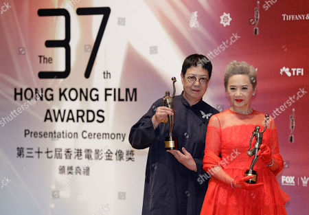 "Ann Hui, Deanie Ip. Hong Kong director Ann Hui, left, and actress Deanie Ip poses after winning the Best Director award for her movie ""Our Time Will Come"" and the Best Supporting Actress award for her movie ""Our Time Will Come"" during the Hong Kong Film Awards in Hong Kong"