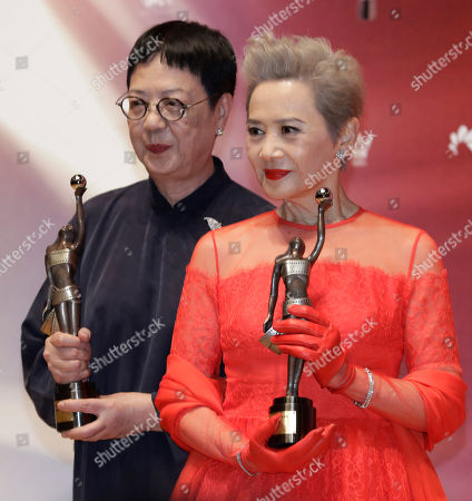 "Stock Image of Ann Hui, Deanie Ip. Hong Kong director Ann Hui, left, and actress Deanie Ip pose after winning the Best Director award for her movie ""Our Time Will Come"" and the Best Supporting Actress award for her movie ""Our Time Will Come"" during the Hong Kong Film Awards in Hong Kong"