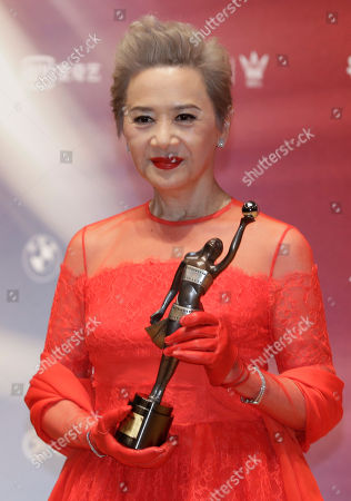 "Stock Photo of Hong Kong actress Deanie Ip poses after winning the Best Supporting Actress award for her movie ""Our Time Will Come"" during the Hong Kong Film Awards in Hong Kong"