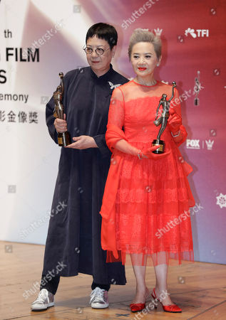 "Stock Photo of Ann Hui, Deanie Ip. Hong Kong director Ann Hui, left, and actress Deanie Ip poses after winning the Best Director award for her movie ""Our Time Will Come"" and the Best Supporting Actress award for her movie ""Our Time Will Come"" during the Hong Kong Film Awards in Hong Kong"