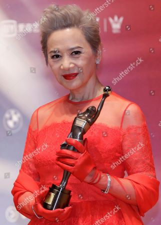 "Hong Kong actress Deanie Ip poses after winning the Best Supporting Actress award for her movie ""Our Time Will Come"" during the Hong Kong Film Awards in Hong Kong"