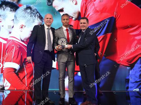 Stock Image of PFA player in the community award, Bobby Reid receives the award for team mate Joe Bryan of Bristol City in-between John Hudson (L) and Shrewsbury Town manager Paul Hurst
