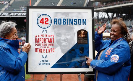Rachel Robinson, Sharon Robinson. Rachel Robinson, left, widow of Jackie Robinson, and daughter Sharon pose for a photograph with a plaque honoring Jackie on Jackie Robinson Day, in New York, before a baseball game between the New York Mets and the Milwaukee Brewers