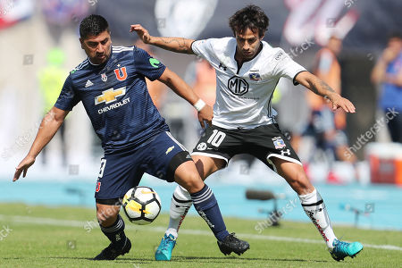 Stock Picture of Colo Colo's player Jorge Valdivia (R) vies for the ball David Pizarro (L) of Universidad de Chile during their match between Universidad de Chile and Colo Colo of the Chile 2018 national championship, at the National stadium, in Santiago, Chile, on 15 April 2018.